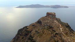To the northeast of Imerovigli is the famous Skaros Rock with Thirassia above it.