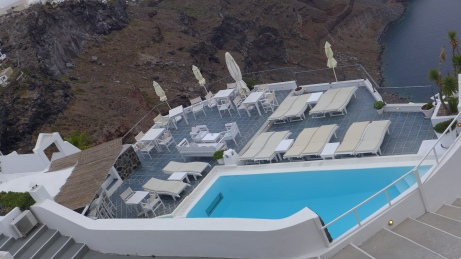 Imagine being in your own private pool with the best view of Santorini.